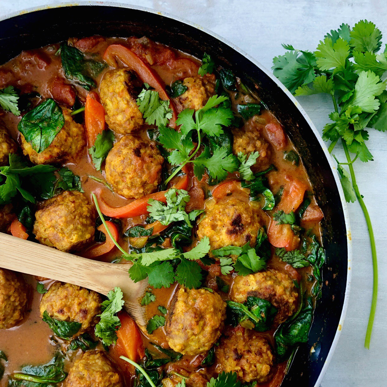 Turkey Meatballs in a Coconut Curry Sauce with Red Pepper and Spinach
